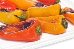 Roasted sweet bite peppers of different colors Stock Photos