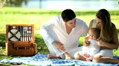 Couple Sitting Outdoors Park Young Baby Stock Footage