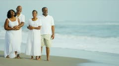 African American Senior Friends Barefoot Beach  Stock Footage