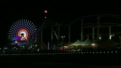 Ferris Wheel At Night With American Flag Above In The Wind HD Stock Footage
