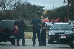 Police Question a Woman 1 Stock Photos