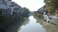 Traditional Chinese houses built on both sides of a river Stock Footage