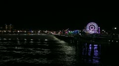 Stock Video Footage of Santa Monica Pier At Night With Santa Monica and Ferris Wheel Showing HD
