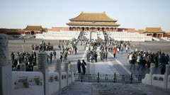 Many groups of tourists inside forbidden city Bejing China Stock Footage