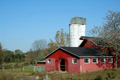 red barn and silo - stock photo