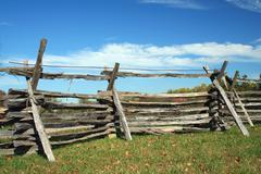 stacked wood fence - stock photo