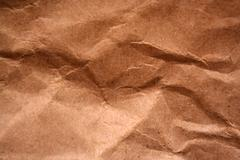 Crinkled  brown paper bag background texture Stock Photos