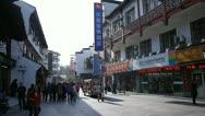 People shopping on Hunan road in Nanjing China Stock Footage