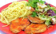 Pork chops with pasta and salad Stock Photos