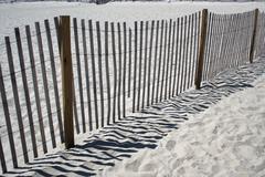 fence on the beach - stock photo