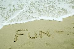 Fun written on beach Stock Photos