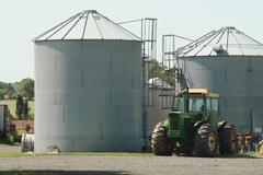 farm tractor and silos - stock photo