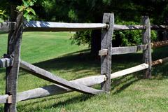 broken wooden rail fence - stock photo