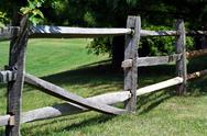 Stock Photo of broken wooden rail fence
