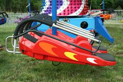 childrens carnival spaceship ride - stock photo