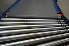 conveyor rollers and belt - stock photo