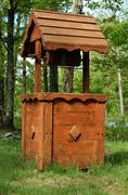 Wooden well - stock photo
