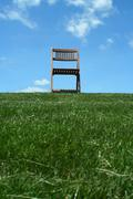 Wooden chair on a hilltop Stock Photos