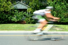 blurred motion bicycle race - stock photo