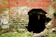 hole in a wall - stock photo
