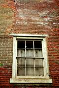window on a abandoned building - stock photo