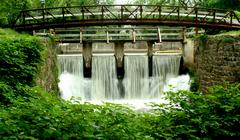 bridge on a canal spillway - stock photo