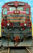 front of a a old train locomotive - stock photo