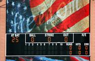 Stock Photo of baseball scoreboard with american flag
