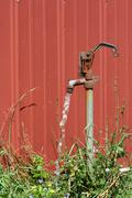 Old water spigot with running water Stock Photos