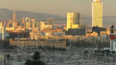 Cable car crosses the Barcelona city skyline Stock Footage