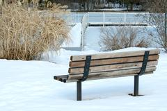 Stock Photo of lonely park bench in winter