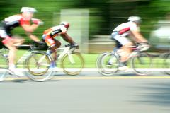 a blurred motion bicycle race - stock photo