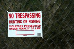 no tespassing sing on fence - stock photo