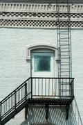 fire escape on the side of a building - stock photo