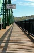 wooden bridge walkway with lone jogger - stock photo