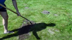 Fast man shorts flip-flop shoes level molehills earth raker Stock Footage
