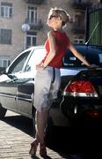blonde woman near black automobile - stock photo
