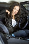 Expressional woman in the sportcar Stock Photos