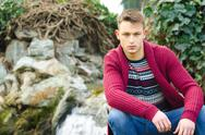 Portrait of handsome young man with winter clothes and blue jeans Stock Photos