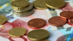 Euro coins on Euro notes Stock Footage