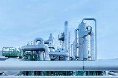 Geothermal energy. pipes details of a power station. Stock Photos