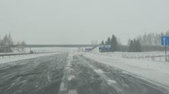 Drive highway. snow fall blizzard. car front window view Stock Footage