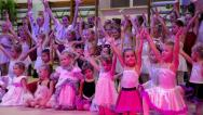 Young girls gymnasts at the New Year's performance in school of gymnastics Stock Footage