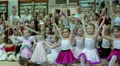 Young girls gymnasts at the New Year's performance in school of gymnastics HD Footage