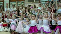 Young girls gymnasts at the New Year's performance in school of gymnastics - stock footage