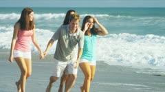 Happy Caucasian Family Running Outdoors on Beach - stock footage
