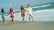 Family Enjoying Spending Time Beach Stock Footage