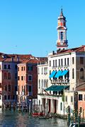 clock tower in grand canal venice, italy. - stock photo