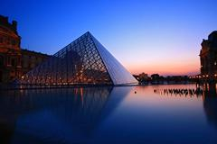 Paris - april 16: s of louvre pyramid at dusk during the egyptian antiquities Stock Photos