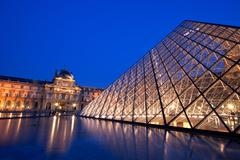 closeup of louvre pyramid - stock photo